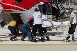 Beyin kanaması geçiren eski başhekim hava ambulansı ile sevk edildi